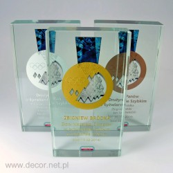 Glass award with a medal...